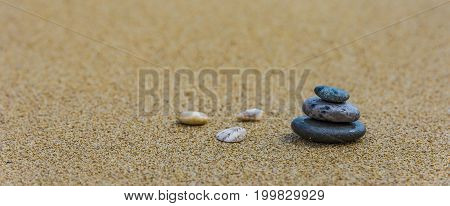 Balance stone on river coast Sand water pebbles relax
