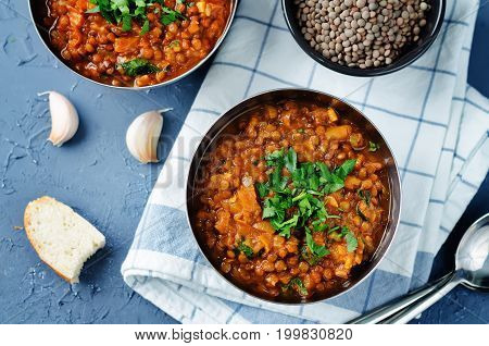 Cabbage Lentil stew on a blue stone background