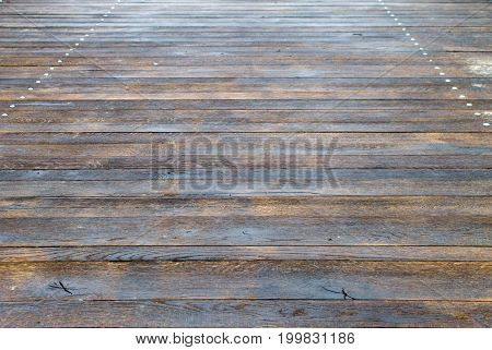 Wooden flooring of transverse planks with iron nails