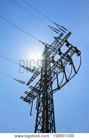 High-tension power line tower carry green electricity sun energy. Ironman business is transmission of renewable sustainable power to prevent climate change and heal the world. Important modernization of grid.