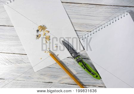 Sharpening A Pencil For Writing A Letter Or A Note. Office Workplace.