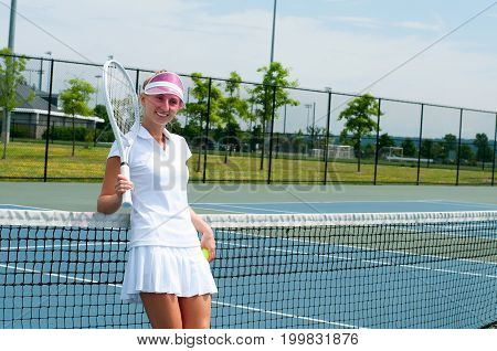 Tennis Player Holding Tennis Racket And Ball  On The Tennis Court