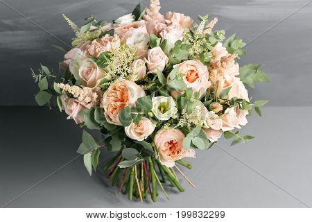beautiful bouquet made of different flowers on grey background. colorful color mix flower.