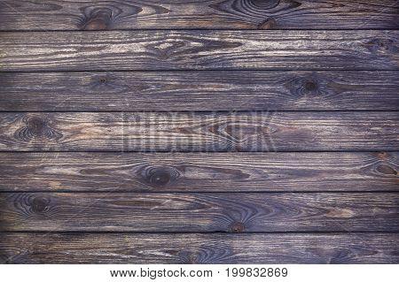 Old scratched wood texture, dark wooden background