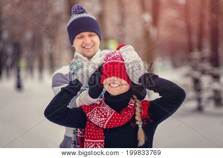 Lovers Man And Woman Having Fun And Playing In Winter Park