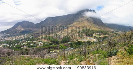 FROM CAPE TOWN, SOUTH AFRICA, VIEW OF TABLE MOUNTAIN ON A CLOUDY DAY 38vv