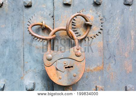 Old rusty padlock on wooden door background with copyspace