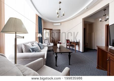 Hotel apartment, bedroom interior in the morning. two-room Suite, with large double bed