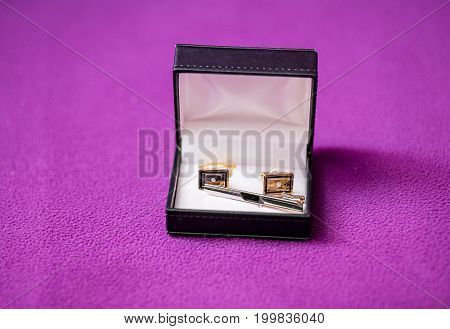 Men's Cufflinks In The Box On Purple Fabric
