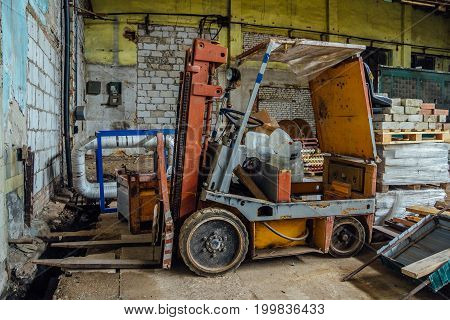 Old forklift in abandoned warehouse in Voronezh