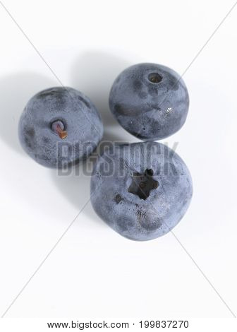 A few loose Blueberries on White Background