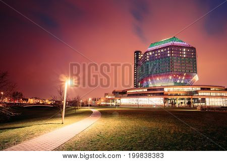 Minsk, Belarus - April 6, 2016: National Library Building In Evening LED Illumination On Blue Sky Background. Famous Hi-Tech Modern Landmark, Cultural Informational Science Center. Night Panorama