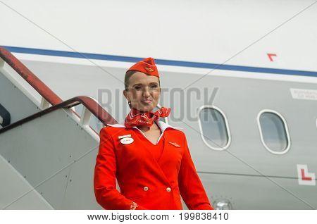 Charming Stewardess Dressed In Red Uniform. Russia, Saint-petersburg. August 10, 2017