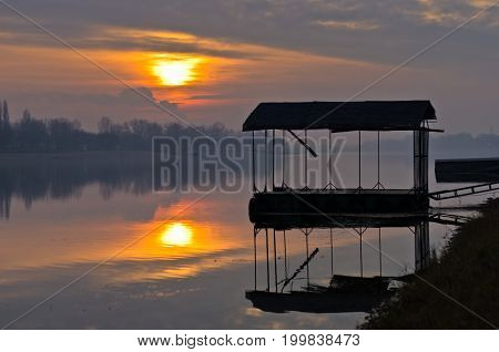 Sunset on a lake at Ada river island in Belgrade, Serbia