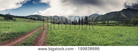 mountain landscape along a dirt trail in altai mountains