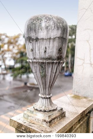 Stone vase outdoor in the facade of old abandoned palace in Abkhazia