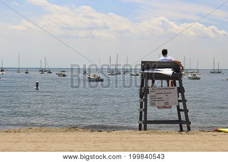 Lifeguard sitting on a chair at the beach