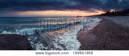 Sunset on the beach with pebbles Abkhazia New Athos