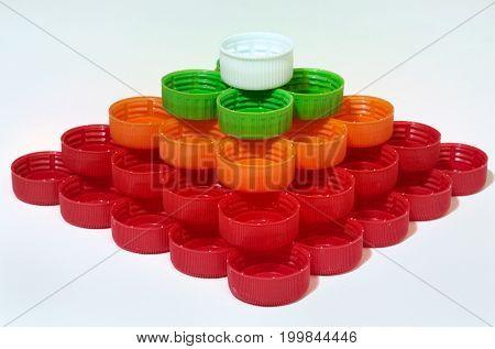 quadrangular pyramid of caps of plastic bottles. Closeup