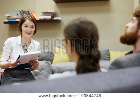 Family psychologist listening to her patients during session