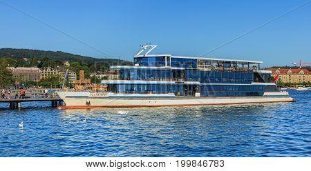 Zurich, Switzerland - 20 July, 2016: MS Panta Rhei at a pier on Lake Zurich in the city of Zurich. MS Panta Rhei is currently the newest ship of the Lake Zurich Navigation Company (German: Zurichsee-Schifffahrtsgesellschaft or ZSG).