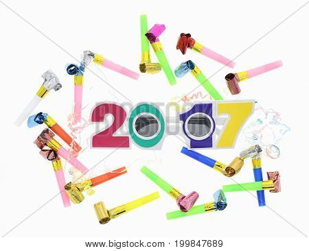 2017 text with eye glasses on New Year Eve celebration background