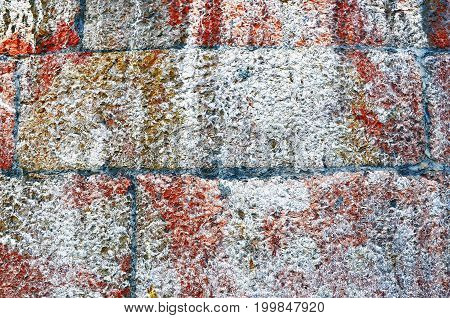 Stone wall near position red white color