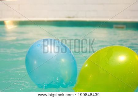 inflatable colored balls floating in the pool