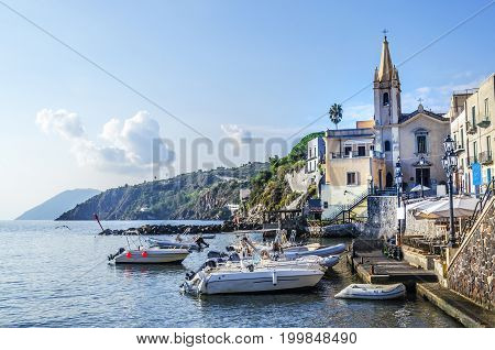 Sports boats are appreciated its berth and the parish of San Giussepe of the year fifteen hundred and forty-five on the island of lipari italy
