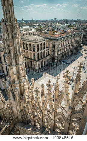 View of Piazza del Duomo from the top of Milan Cathedral (Duomo) in Milan, Italy. Milan Duomo is the largest church in Italy and the fifth largest in the world.