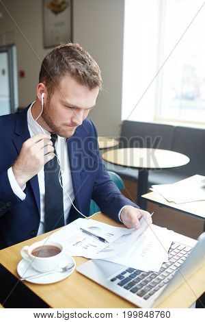 Businessman networking and analyzing financial papers