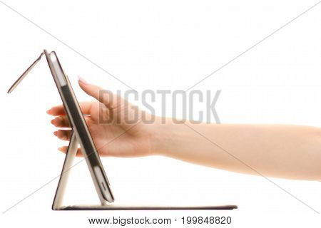 Tablet in female hands on white background isolation