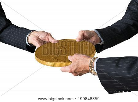 Hands of three financial traders gripping gold eagle coin isolated against a white background