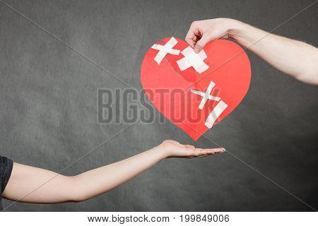 Man Hand Giving Someone Broken Heart