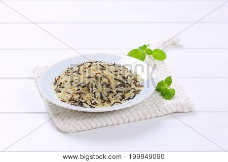 plate of wild rice on white table mat