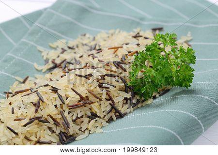 pile of wild rice on grey place mat - close up