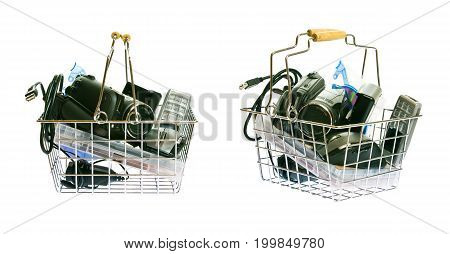 a shopping basket full with various electronics mobile phone, camcorder, dvds, cables... - side and diagonal view