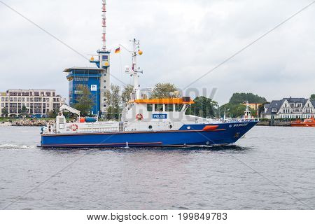 WARNEMUENDE / GERMANY - AUGUST 12 2017: german police ship drives at public event hanse sail in warnemuende germany.