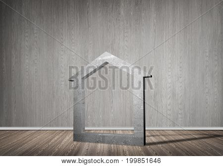 House stone figure as symbol of real estate in empty concrete room