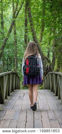 Beautiful Pretty Blonde School Girl Child From Back With White Shirt, Purple Skirt And Backpack Stan