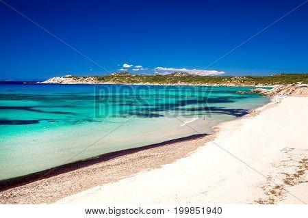 Spiaggia Di Rena Maiori Beach With Azure Clear Water And Mountains, Rena Majore, Sardinia, Italy.