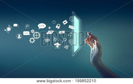 the hand touching the sceen with a lot of icon throw out from sceen technology about internet of thing concept.