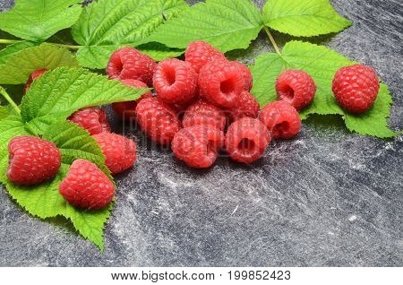 Raspberry on black background close up photo