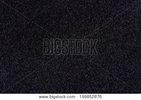 Black velvet background. Dark velvet surface close-up