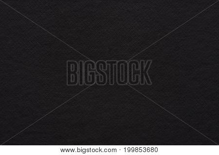 Empty black paper texture. Textured dark paper background