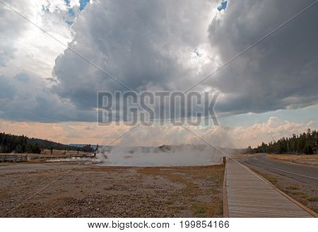 Boardwalk between Hot Lake hot spring and Firehole Lake drive in the Lower Geyser Basin in Yellowstone National Park in Wyoming United States