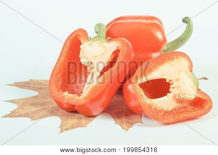 Vintage Photo, Red Peppers With Autumnal Leaf On White Background, Healthy Nutrition And Autumn Conc