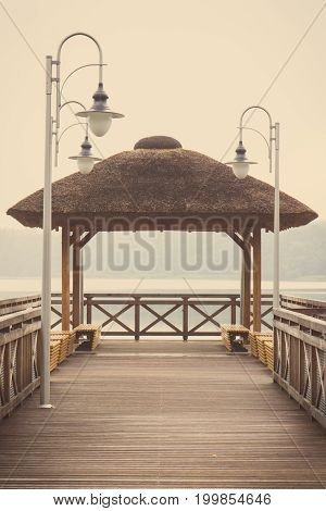 Vintage Photo, Wooden Pier At Lake On Cloudy Day