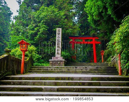 Red Tori Gate at Fushimi Inari Shrine, with stoned stairs located in Kyoto, Japan.