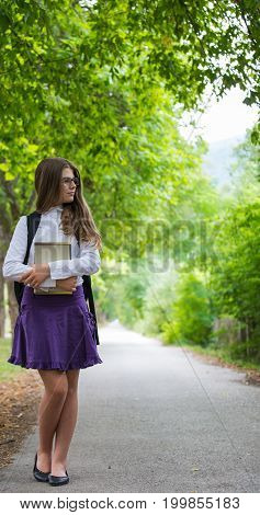 Pretty Beautiful Blonde Child Schoolgirl Back To School Taking A Walk Through Tree Alley In Nature H